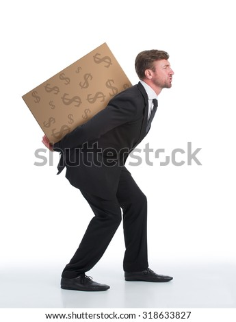 Successful businessman is a real professional in his company. Man in black business suit carrying heavy load with money on his back isolated on white. - stock photo