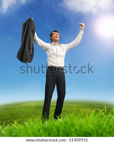 Successful businessman on a field - stock photo