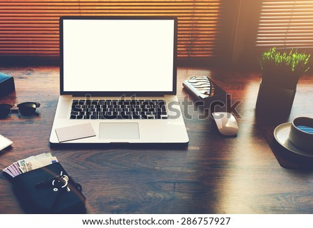 Successful businessman or entrepreneur table with style accessories, euro bills, open laptop computer or notebook with white blank copy space screen for text information or content, e-business, filter - stock photo