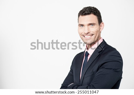 Successful businessman posing with folded arms - stock photo