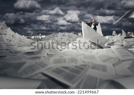 Successful businessman sailing on paper boat - stock photo