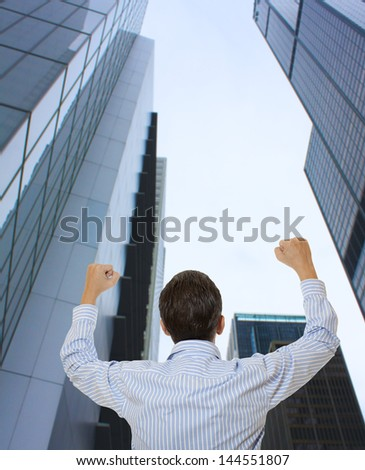 Successful businessman standing in shirt wide open in front of buildings business center - stock photo
