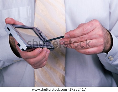 Successful businessman wearing shirt and tie, working... Closeup of pda organizer (palmtop) - stock photo