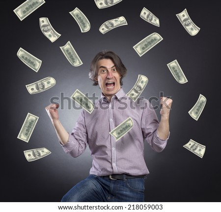 Successful businessman with a pile of money. - stock photo