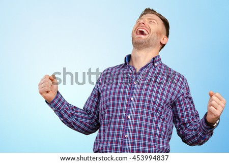 Successful businessman with arms up celebrating his victory - stock photo