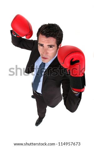 Successful businessman with boxing gloves - stock photo