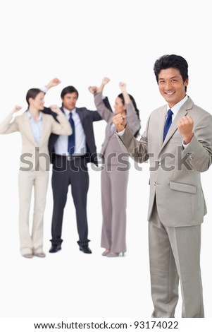 Successful businessman with cheering team against a white background - stock photo