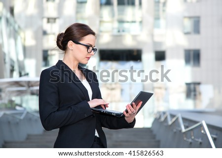 Successful businessman working at laptop. Business woman working. Sales woman working using her laptop while writing text. Businesswoman in glasses working on-line. - stock photo
