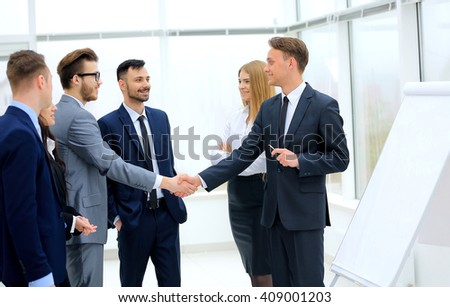Successful businessmen handshaking after presentation - stock photo