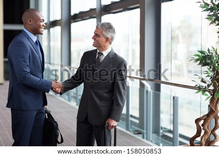 successful businessmen meeting at airport - stock photo