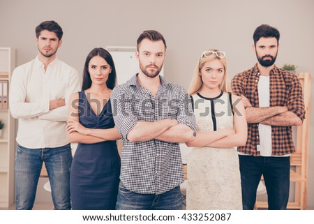 successful businesspeople  crossing hands  and looking at camera - stock photo