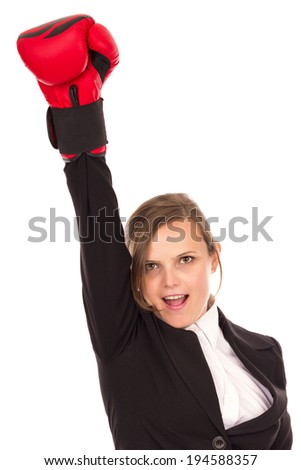 Successful businesswoman celebrating with one arm in air wearing boxing gloves - business concept-isolated over white background - stock photo