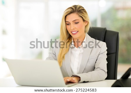successful businesswoman using computer in office - stock photo