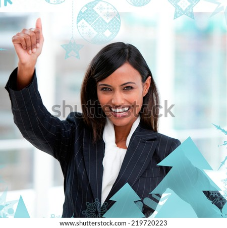 Successful businesswoman with a thumb up standing against christmas frame - stock photo