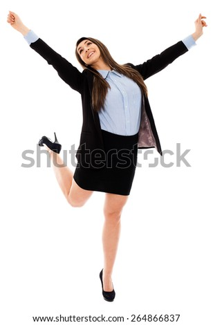 Successful businesswoman with arms raised in the air, expressing victory - stock photo