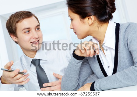 Successful colleagues discussing plans in office - stock photo