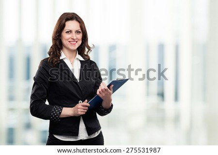 Successful confident middle age businesswoman smiling in her office, holding a file in her hands. Isolated on white. - stock photo