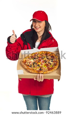 Successful  delivery worker woman giving thumb up and showing big pizza ,selective focus on pizza,isolated on white background - stock photo