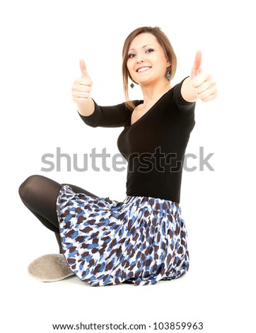 successful elegant young woman with thumbs up, full length, white background - stock photo