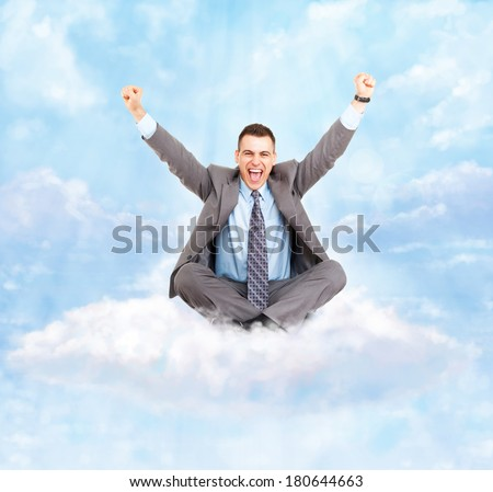 Successful excited business man happy smile hold fist gesture sitting on white cloud with clear blue sky, businessman with raised hands arms, wear suit and tie, concept of success - stock photo