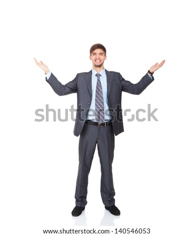 Successful excited business man happy smile hold wide open palm gesture, handsome young businessman with raised hands arms, full length isolated over white background - stock photo