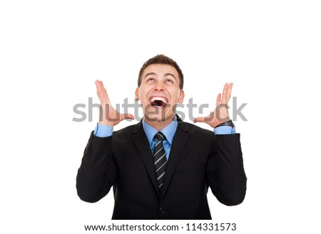 Successful excited business man happy smile looking up to empty copy space hold open palm, handsome young businessman with arms wide open, wear elegant suit and tie isolated over white background - stock photo