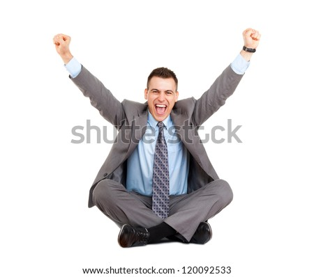 Successful excited businessman happy smile hold fist ok yes gesture, business man sitting in yoga lotus pose on floor with raised hands arms, full length isolated over white background - stock photo