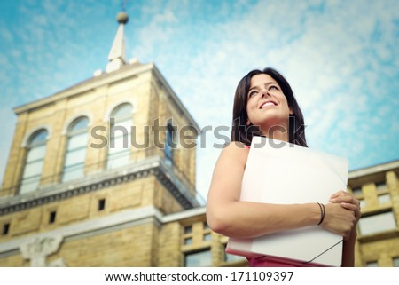 Successful female college student portrait in university campus. Education success and future opportunities concept. - stock photo