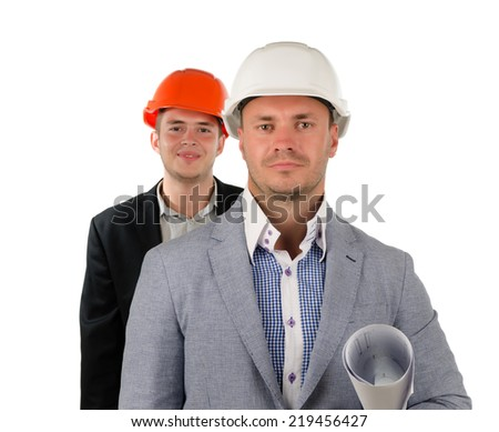 Successful foreman or supervisor of a construction team in his hardhat with a blueprint under his arm and a team member behind him, on white - stock photo