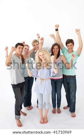 Successful friends standing against white background - stock photo