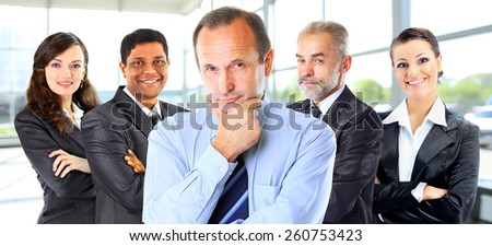 Successful group of business people at the office - stock photo
