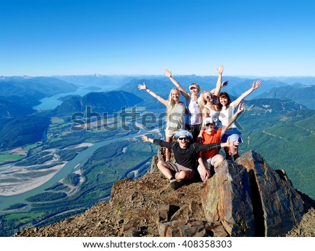 Successful Group of Happy Friends on Mountain Top, Cheering.  Mount Cheam Summit,  British Columbia, Canada.  - stock photo