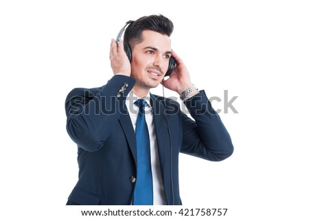 Successful handsome businessman listening and enjoying his favorite music on headset isolated on white background - stock photo