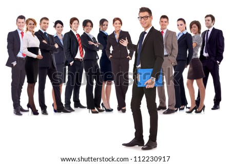 Successful happy business team being presented by a young leader, on white background. young business man welcoming you to his business team - stock photo