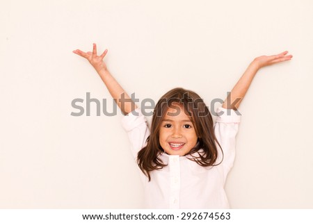 successful, happy little girl playing - stock photo