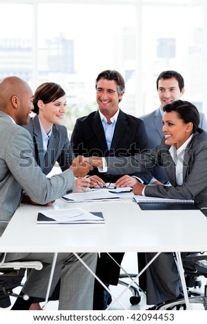 Successful international business people shaking hands in the office - stock photo