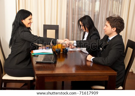 Successful job interview  ,two business people giving hand shake and smiling - stock photo