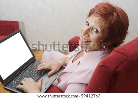 Successful lady with laptop with blank space in the monitor free for write. with clipping path in monitor - stock photo