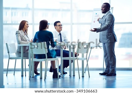 Successful male presenting his project at seminar in office - stock photo
