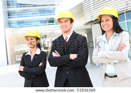 Successful man and woman construction team at work site - stock photo