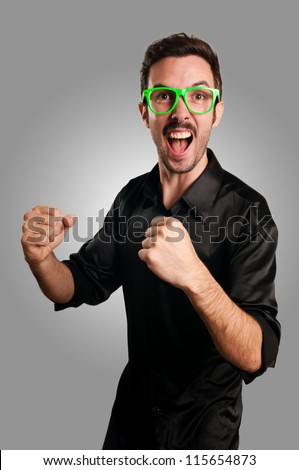 successful man with green eyeglasses on gray background - stock photo