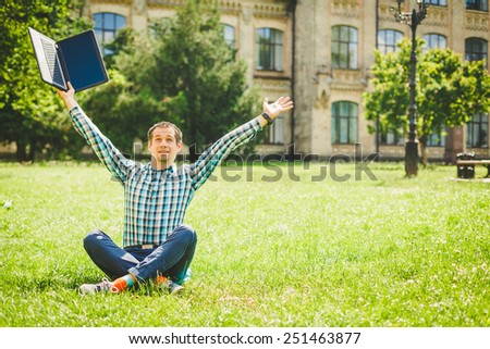 Successful man working outdoor with a laptop - stock photo