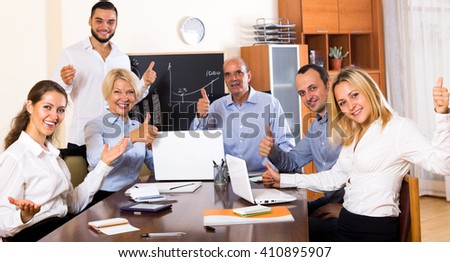 successful office staff gathered in the conference hall for the meeting. Focus on the left and right woman - stock photo