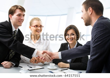 Successful people shaking hands making a necessary agreement - stock photo