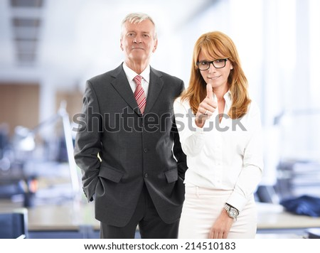 Successful sales team working together at office. Business people. - stock photo