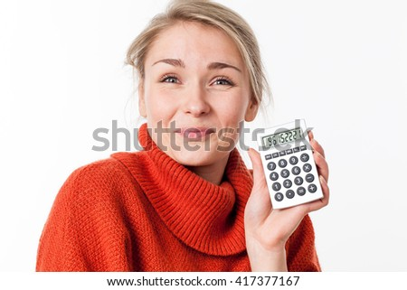 successful savings - satisfied young blond female student enjoying showing her calculator with exciting financial solutions, isolated over white background - stock photo