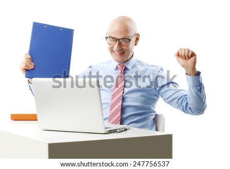 Successful senior businessman sitting in front of laptop while holding folder in hand and reading good news. Isolated on white background. - stock photo