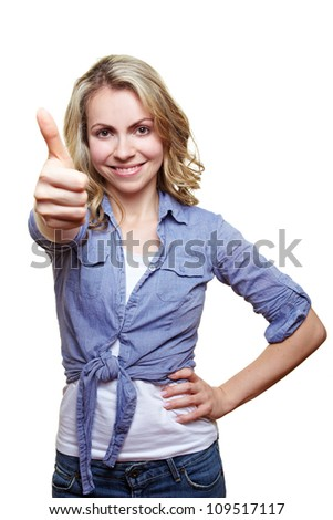 Successful smiling blonde woman holding her thumb up - stock photo