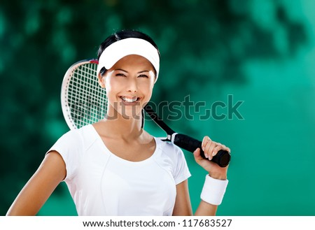 Successful sportswoman with racquet at the tennis court. Healthy lifestyle - stock photo