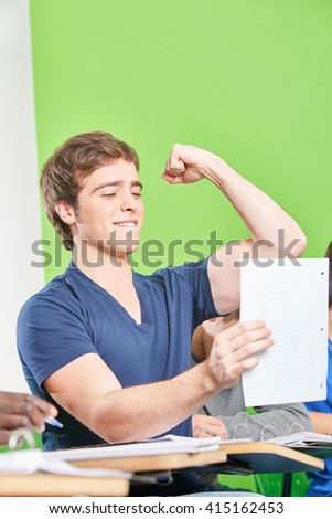 Successful student celebrates his test results in high school - stock photo
